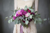 Bridal bouquet with red and burgundy colors — Stock Photo