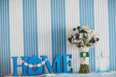 Bridal bouquet of Gypsophila and home plate — Stock Photo