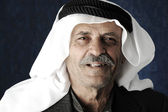Mature Arabic man with traditional clothes, portrait — Stock Photo
