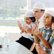 Stock Photo: Muslim father praying with kids for Ramadan