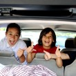 Smiling happy children in car with thumb up — Stock Photo #18865631