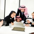 Stock Photo: Arabic Muslim family having photo shooting