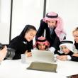 Arabic Muslim family having photo shooting — Stock Photo