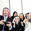 Stock Photo: Arabic Muslim with children at home