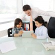 Arabic Muslim father teaching his sons in office — Stock Photo #18866825