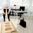 Muslim business man praying at office - Lizenzfreies Foto