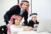 Arabic Muslim business with children at office — Stock Photo