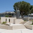Monument to Archbishop Makarios III on the background of the city gymnasium. Larnaca, Cyprus — Stock Photo #22344749