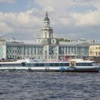Stock Photo: Walking tourist ship on background of building of Kunstkammer. Saint-Petersburg