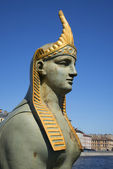 The head of the Sphinx. Detail of sculpture of the Egyptian bridge — Stock Photo