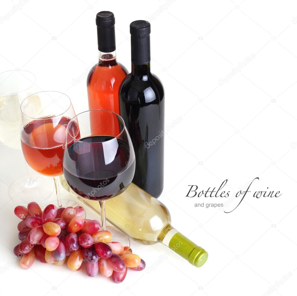Wineglass, bottles of wine and grapes — Stock Photo #14042044