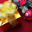 Gold gift box and christmas decoration — Stock Photo