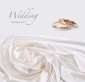 Wedding rings on silk background — Stock Photo