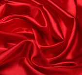 Red silk fabric background — Stock Photo