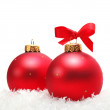 Red Christmas balls in snow — Stock Photo