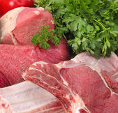 Assortment of raw meat with vegetables — Stock Photo