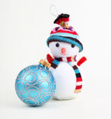 Christmas ball and snowman on white — Stock Photo