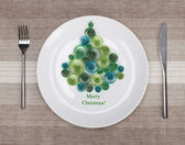 White plate with christmas tree — Stock Photo
