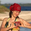 Girl with coral souvenir in the form of heart — Stock Photo