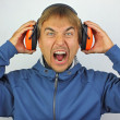 Stock Photo: Screaming mwith headphones