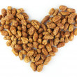 Sugar covered roasted peanuts, heart — Stock Photo