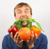 Man gone mad on fresh vegetables and fruits — Stock Photo