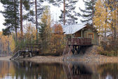 Russian bathhouse on the bank of the lake — Stock Photo