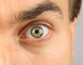 Male eye, menacing-looking — Stock Photo