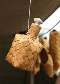 Bottle made of birch bark hanging by a thread — Stock Photo