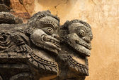 Statue of two faces on the facade of ancient temple in Bagan(Pag — Stock Photo