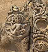 Old cracked bas-relief of religious creature  — Stock Photo