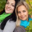 Two happy young women in autumn forest — Stock Photo #12346219