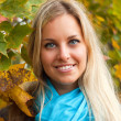 Beautiful young woman in autumn forest — Stock Photo #12346220