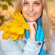 Beautiful young woman in autumn forest — Stock Photo #12346222