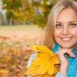 Beautiful young woman in autumn forest — Stock Photo #12346224