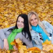 Stock Photo: Two happy young women in autumn forest