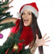 Funny girl near christmas tree — Stock Photo #4222330