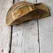 Worn Hat On Weathered Wood — Stock Photo