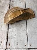 Worn Hat On Weathered Wood — Stock Photo