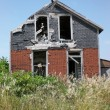 Decaying abandoned rural house — Stock Photo #2240528