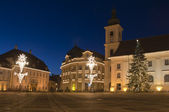 Christmas tree and lights in old town square — Stock Photo