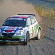 Rally car on gravel - Stock Photo
