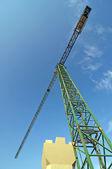Crane and concrete pile — Stock Photo