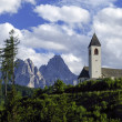 Church and Dolomite range in northern Italy (South Tyrol) - Stock Photo