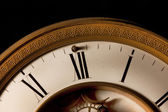 Midnight strikes focus on 12 o clock on an old clock — Stock Photo