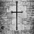 Stock Photo: Christicrucifix or cross in stone work of chapel wall
