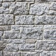Granite stone wall blocks of bricks background — Stock Photo