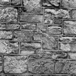 Stock Photo: Different sizes of grye brick wall textured background