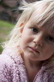 Girl age 2 or 3 looking concerned or worried — Stock Photo