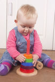 18 month old babby playing with wooden toy — Stock Photo
